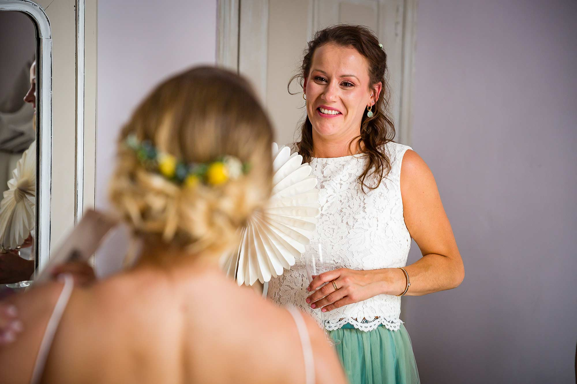 bridesmaid laughing with bride