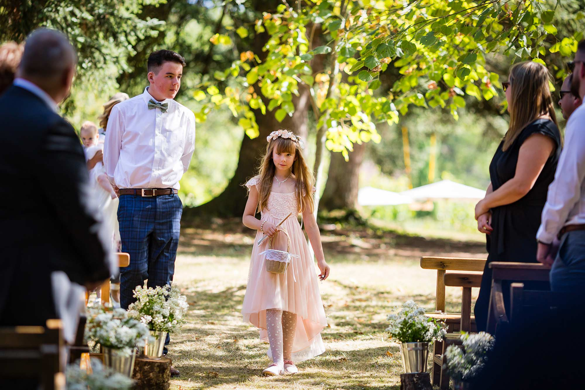 flower girl walks down the aisle at Domaine le Castelet wedding