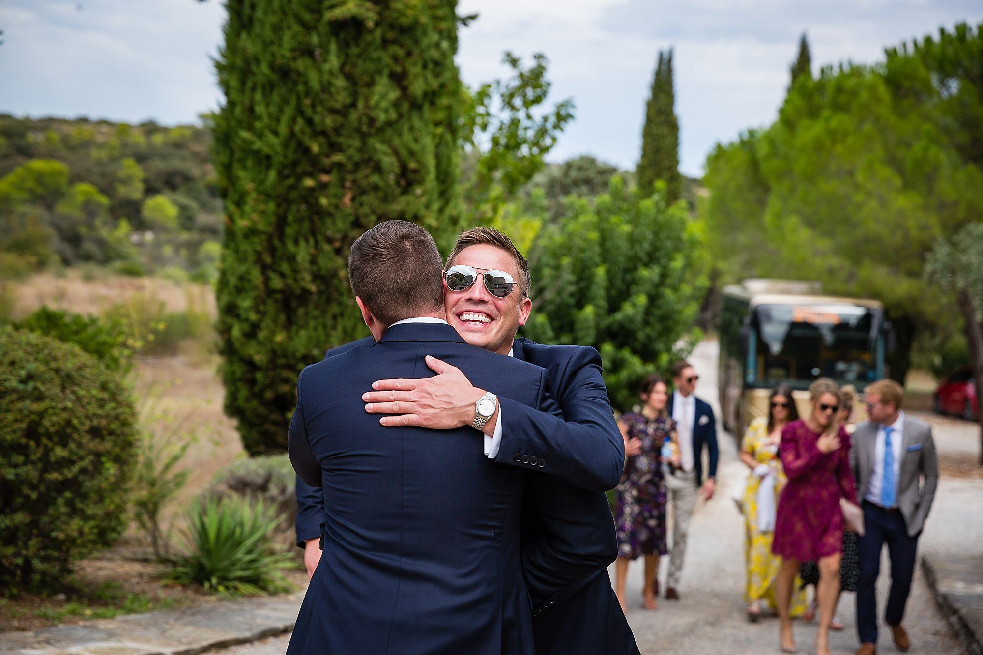 groom hugs bestman