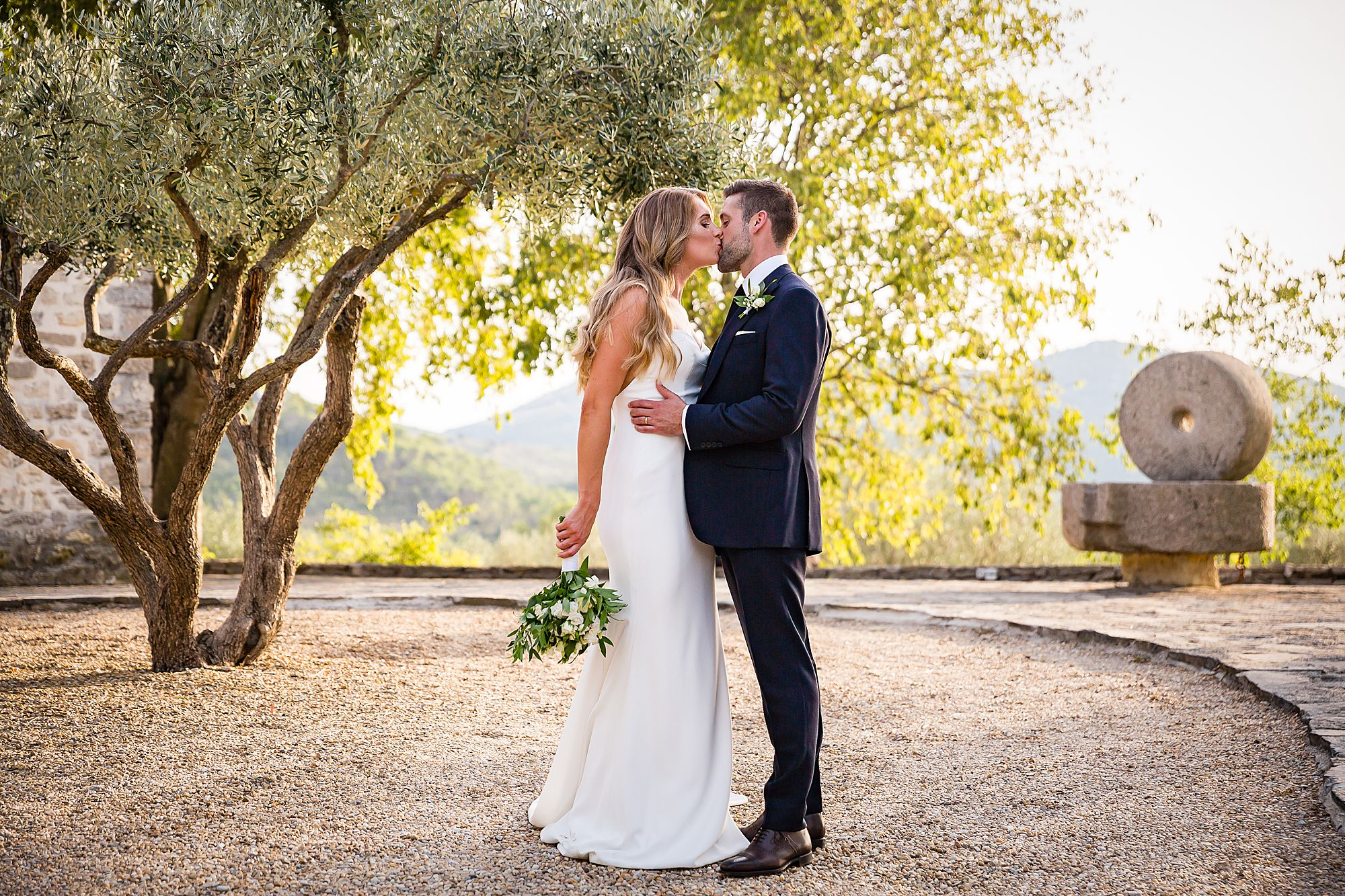 kissing in at their south of France wedding