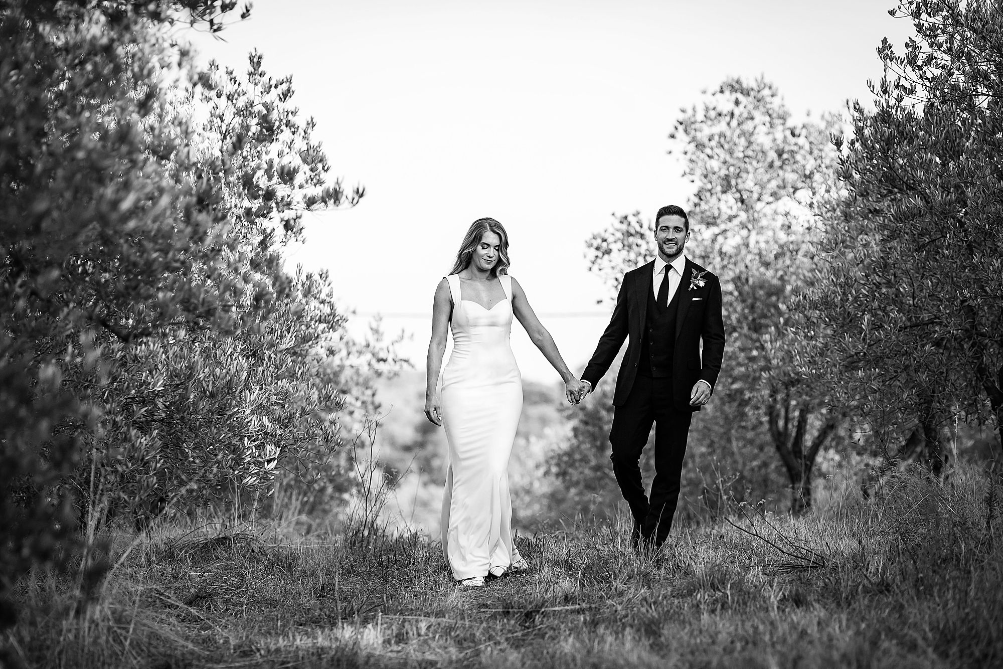 wedding walking though olive groves