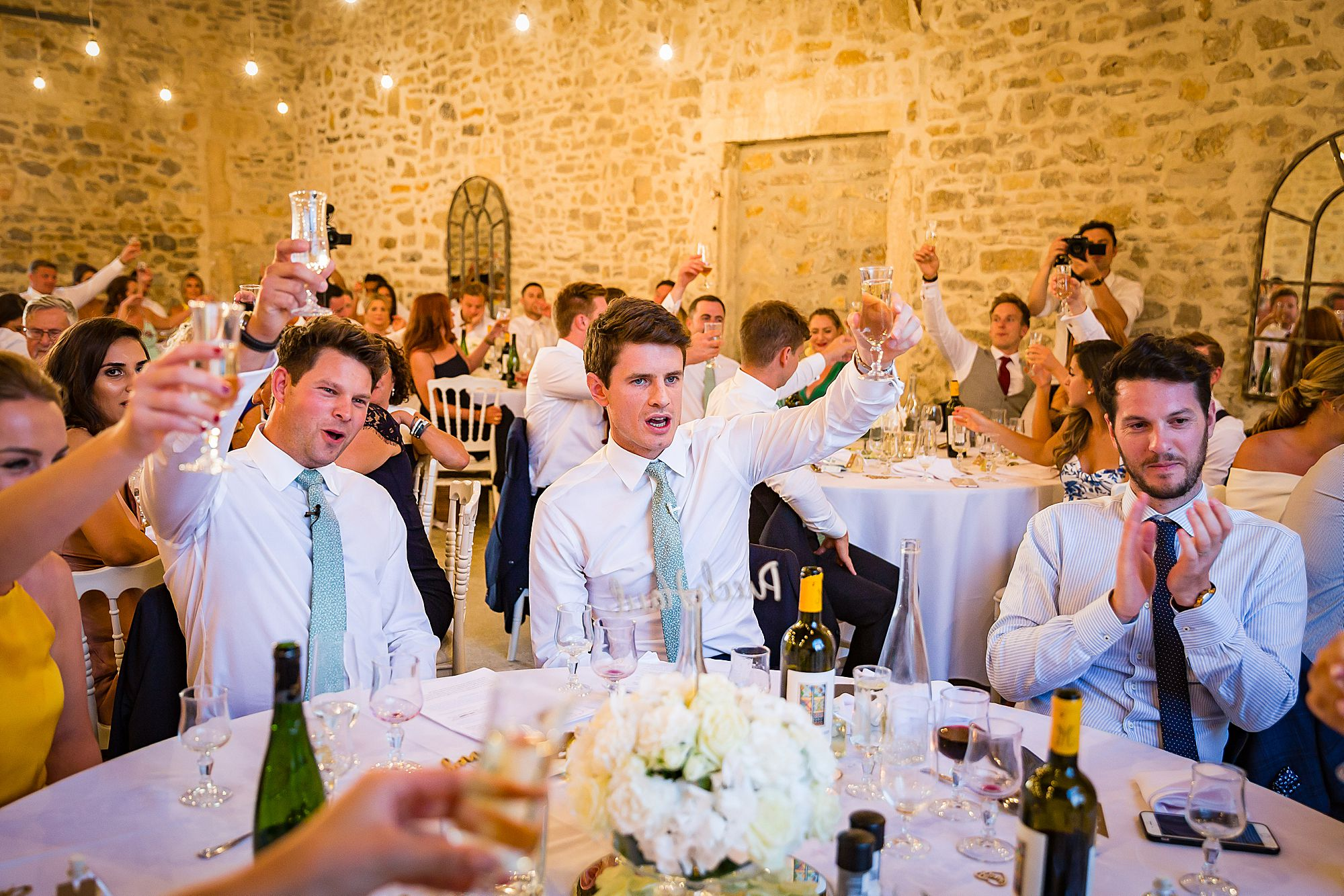 guests raise their glasses to the couple