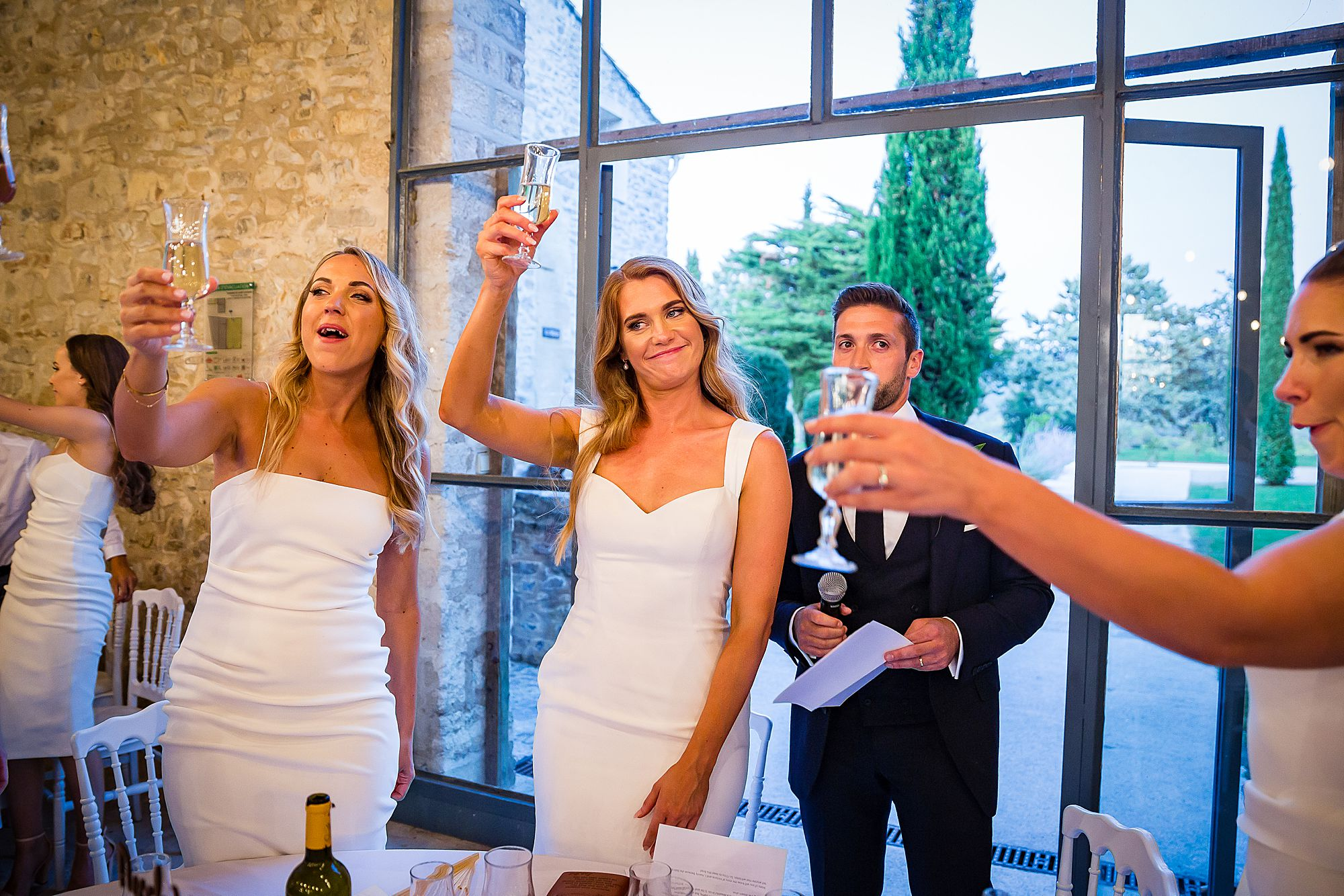 bride raises a glass